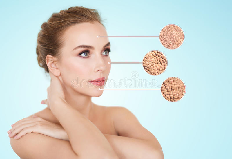 Beautiful young woman face with dry skin sample. Beauty, people and bodycare concept - beautiful young woman face with dry skin sample over blue background royalty free stock photos