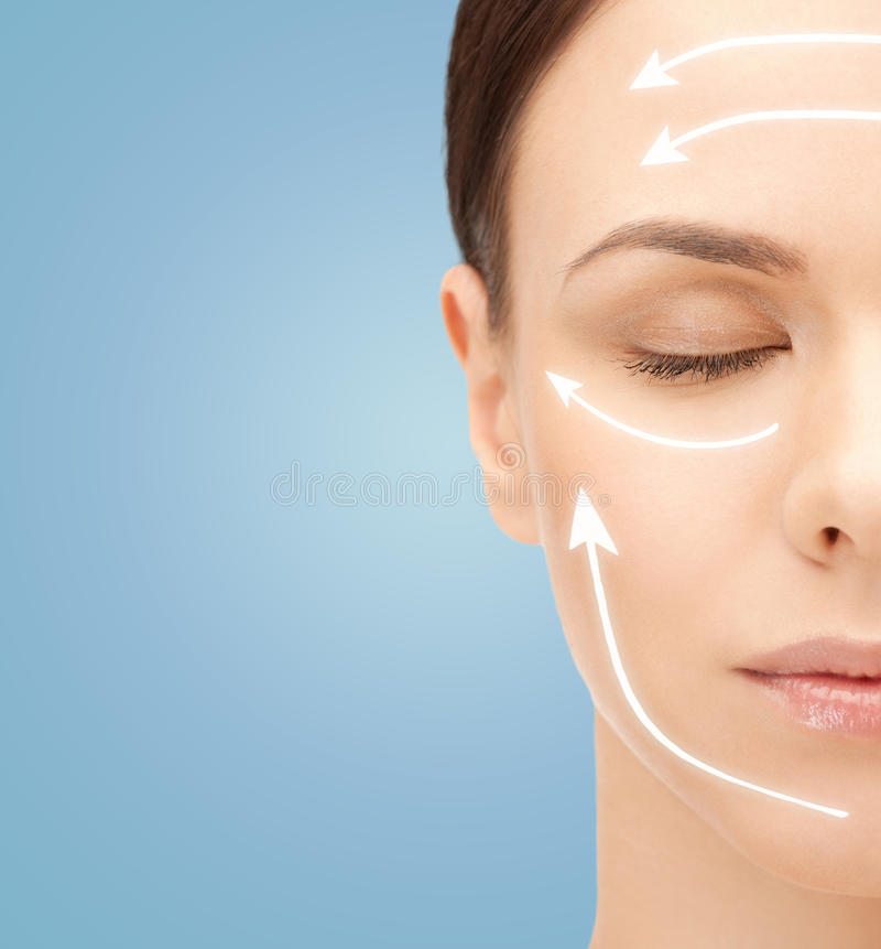 Beautiful young woman face with facelift marks stock images