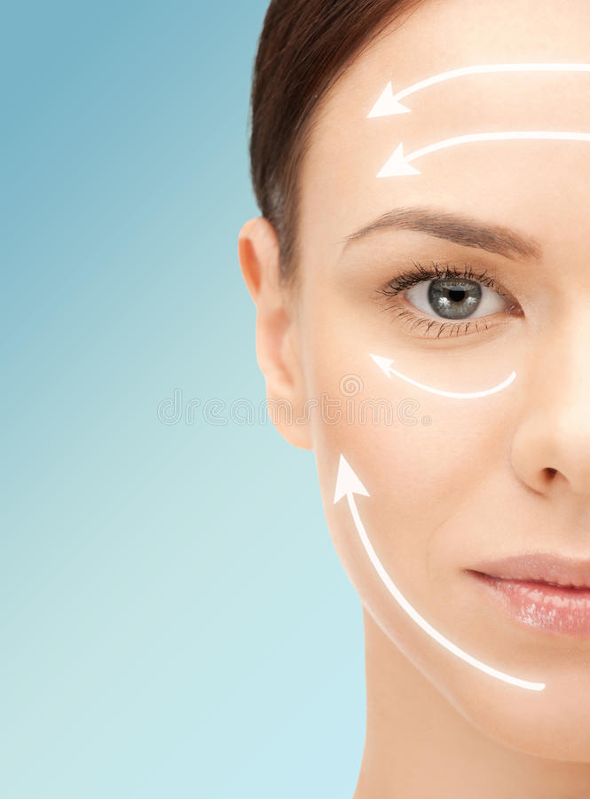 Beautiful young woman face with facelift marks stock photos
