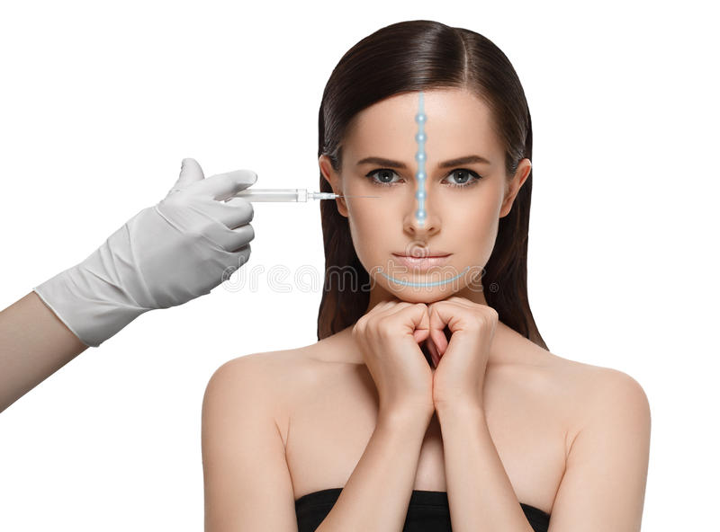 Beautiful young woman face and hand in glove with syringe making royalty free stock photos