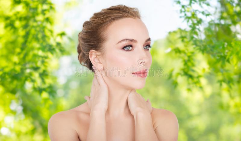 Beautiful young woman face and hands stock photos