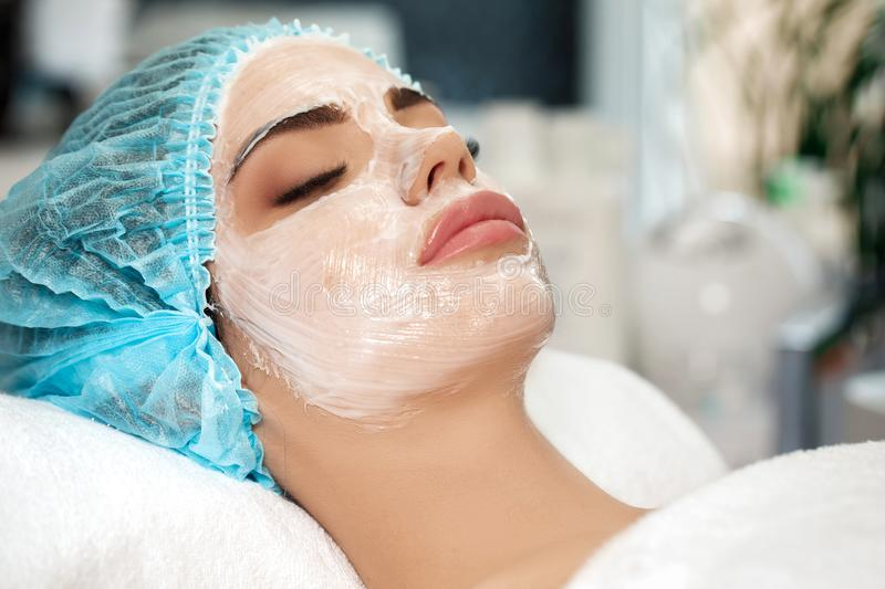 Beautiful young woman with face mask stock images