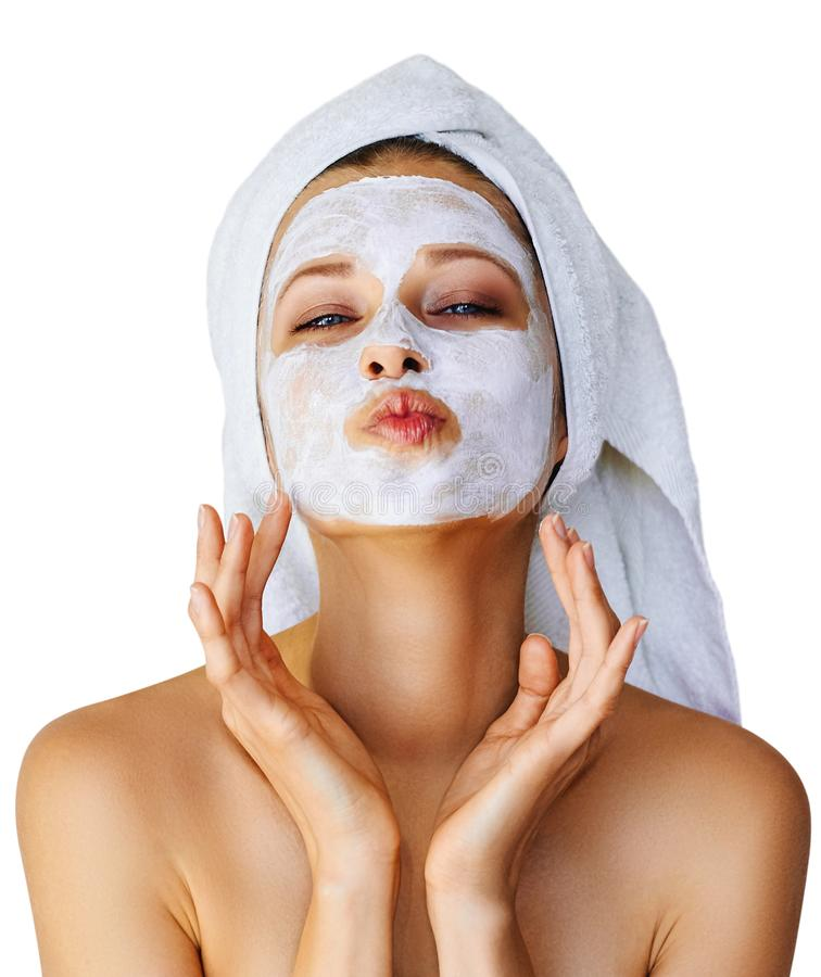 Beautiful young woman with facial mask on her face. Skin care and treatment, spa, natural beauty and cosmetology concept, isolated stock photography