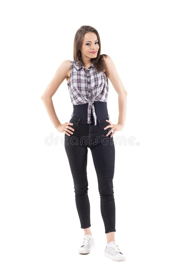 Beautiful young woman fashion model in funky style clothes posing with arms on hips royalty free stock images