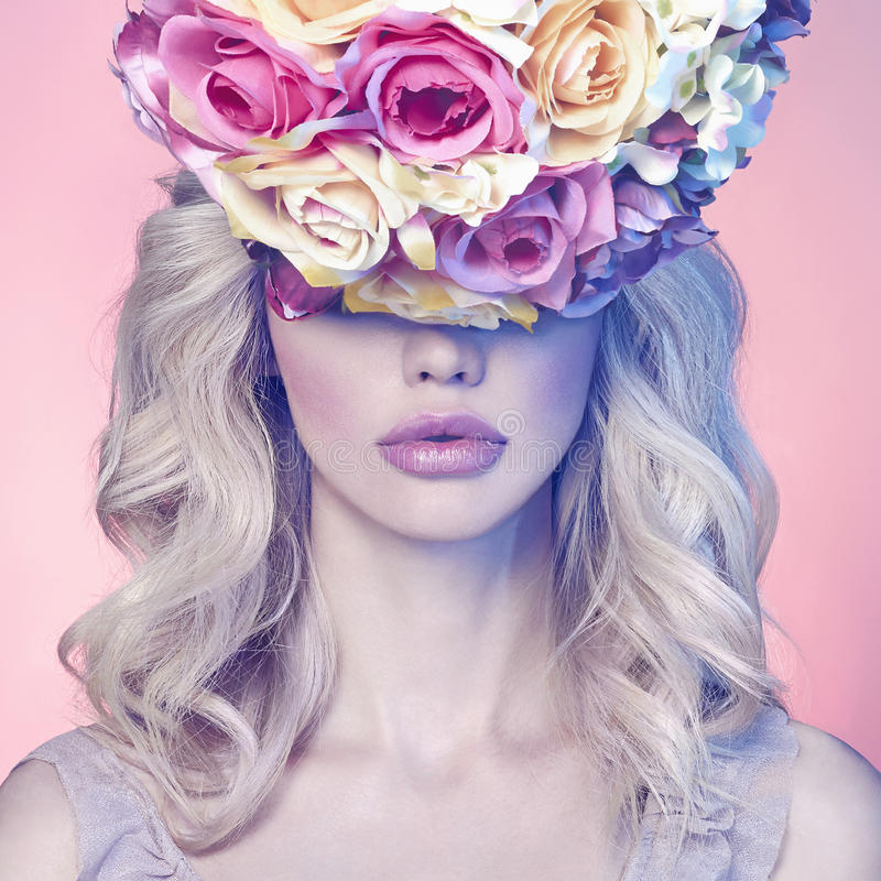 Beautiful young woman with floral hat royalty free stock images