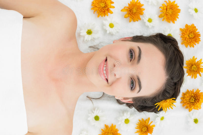 Beautiful young woman with flowers in beauty salon royalty free stock photos