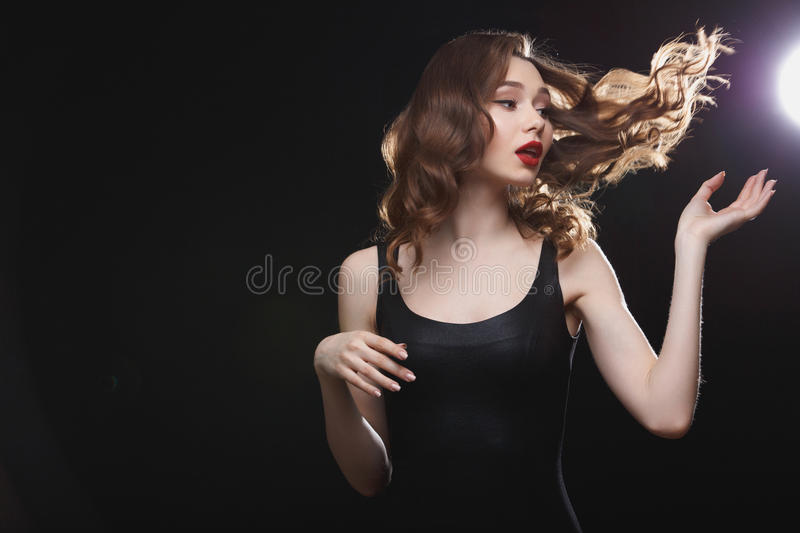 Beautiful young woman with flying hair and red lips royalty free stock photo