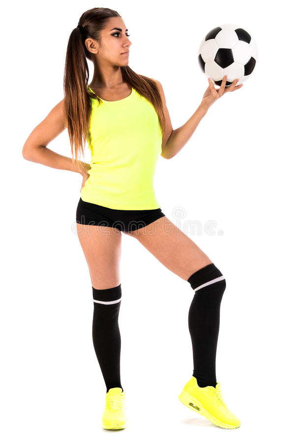 Beautiful young woman with a football stock photo