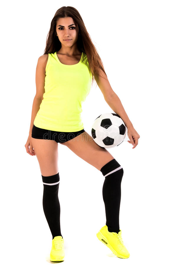 Beautiful young woman with a football stock images
