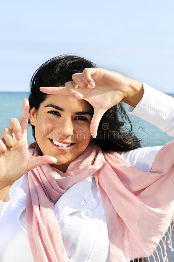 Free Beautiful Young Woman Framing Her Face Stock Images - 9904844