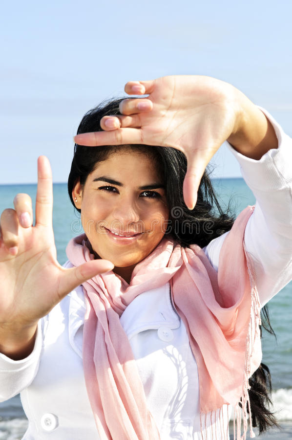 Download Beautiful Young Woman Framing Her Face Stock Image - Image: 9959747
