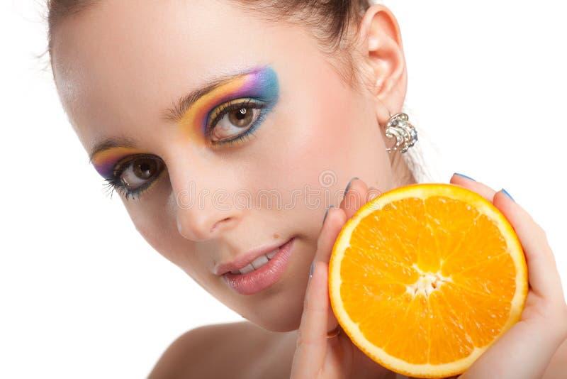 Beautiful young woman with fresh orange. stock photo