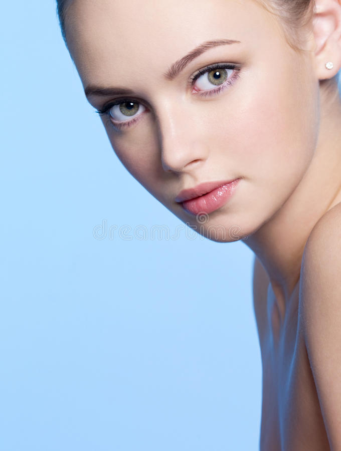 Beautiful young woman with fresh skin. Close-up face of beautiful young woman with fresh skin stock photography