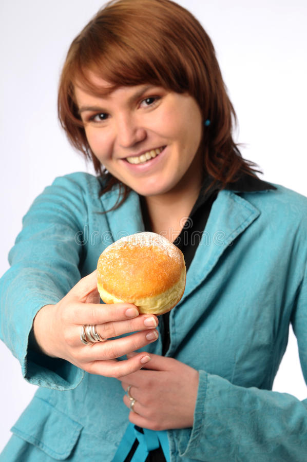 The beautiful young woman with friedcake stock image