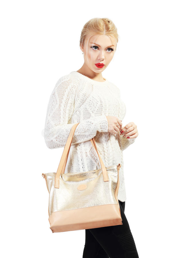 Beautiful young woman. Full length portrait of beautiful blond young woman standing and holding bag in her hands isolated on white in photostudio stock image