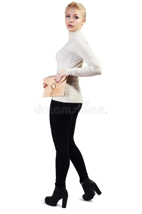 Beautiful young woman. Full length portrait of beautiful blond young woman standing and holding bag in her hands isolated on white in photostudio royalty free stock photos