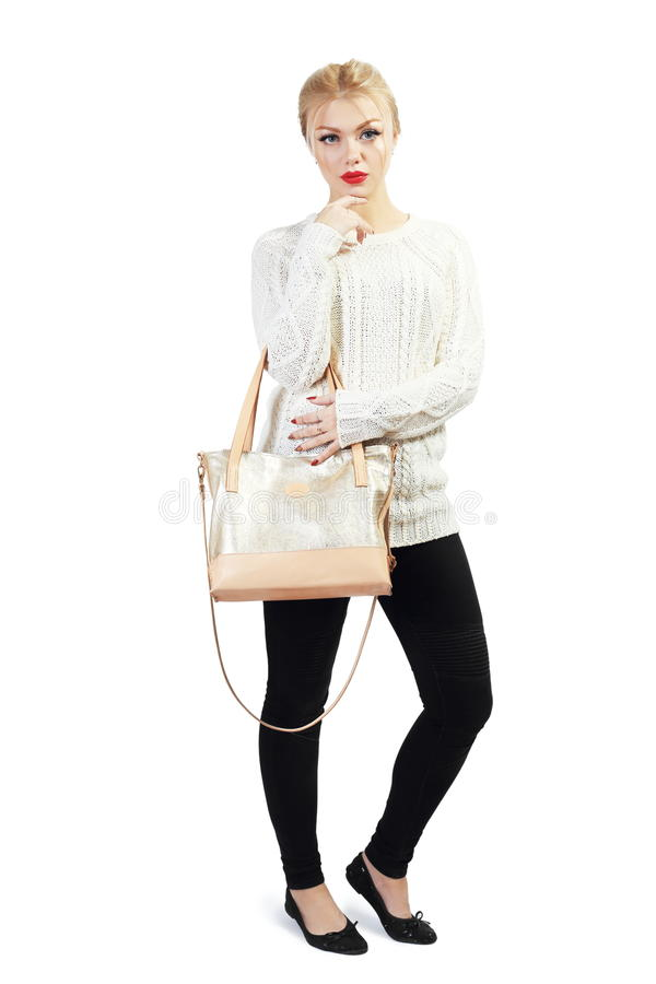 Beautiful young woman. Full length portrait of beautiful blond young woman standing and holding bag in her hands isolated on white in photostudio royalty free stock images