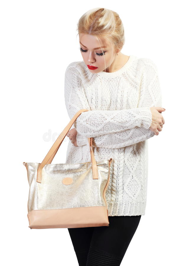Beautiful young woman. Full length portrait of beautiful blond young woman standing and holding bag in her hands isolated on white in photostudio stock photography