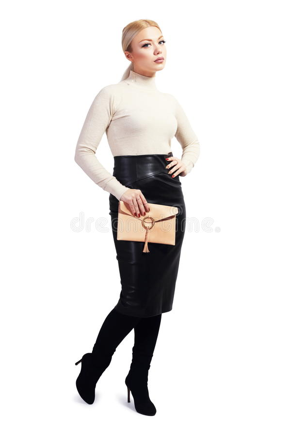 Beautiful young woman. Full length portrait of beautiful blond young woman standing and holding bag in her hands isolated on white in photostudio stock photos