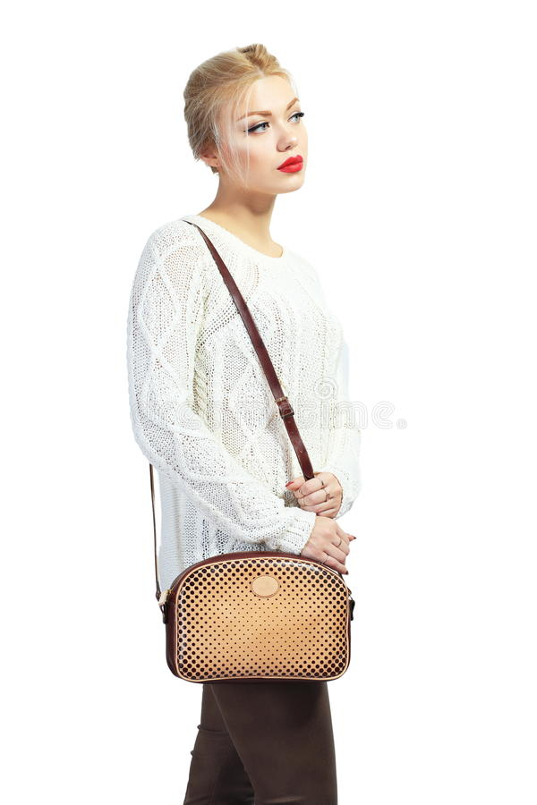 Beautiful young woman. Full length portrait of beautiful blond young woman standing and holding bag in her hands isolated on white in photostudio royalty free stock photo