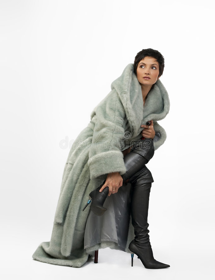 Download Beautiful Young Woman In A Fur Coat. Royalty Free Stock Photo - Image: 376885