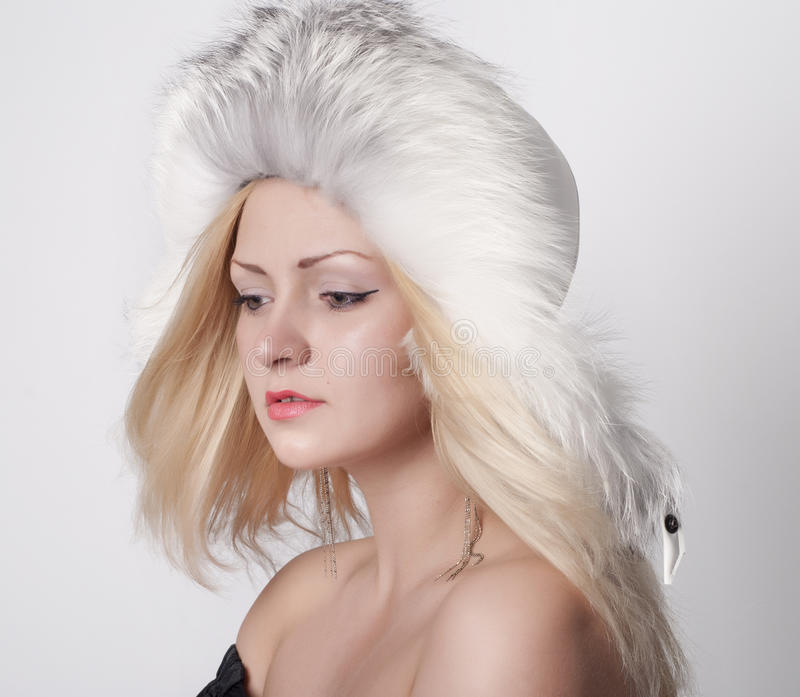 Download Beautiful Young Woman In Fur Hat Stock Photo - Image: 24675628