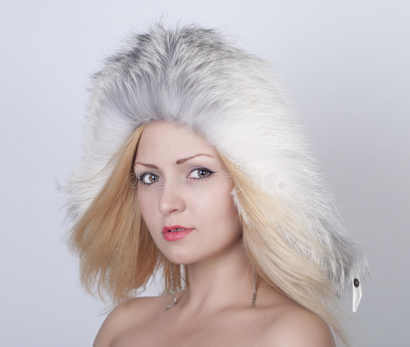 Download Beautiful Young Woman In Fur Hat Stock Photo - Image: 24675636