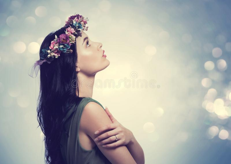 Beautiful young woman with a garland stock image