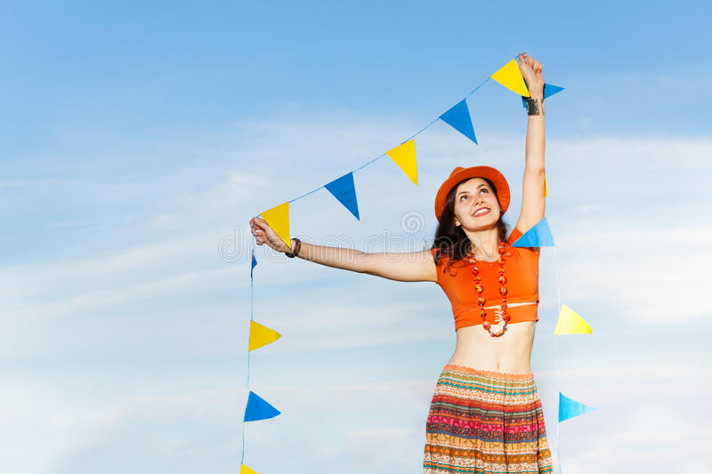 Beautiful young woman with garland of flags royalty free stock images