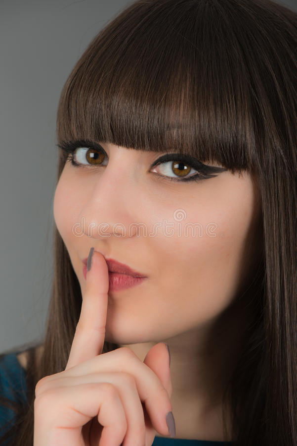 Download Beautiful Young Woman Gesturing For Silence By Holding A Finger Stock Image - Image: 30899101