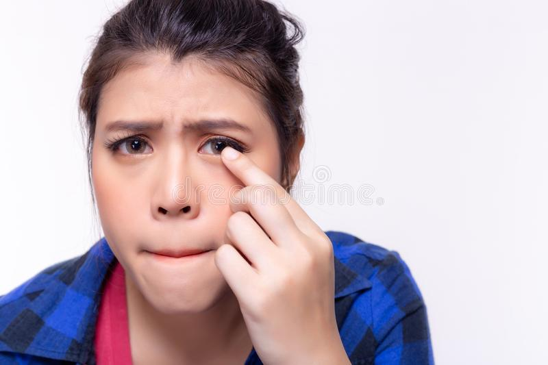 Beautiful young woman get allergic to contact lenses. Young lady gets hurt, painful, unhappy. Pretty girl gets conjunctivitis from. Dirty contact lenses. It is royalty free stock photos