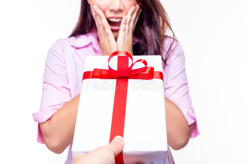 Beautiful young woman get surprised when her boyfriend give present of gift to beautiful girlfriend. It is celebrated of marriage royalty free stock image