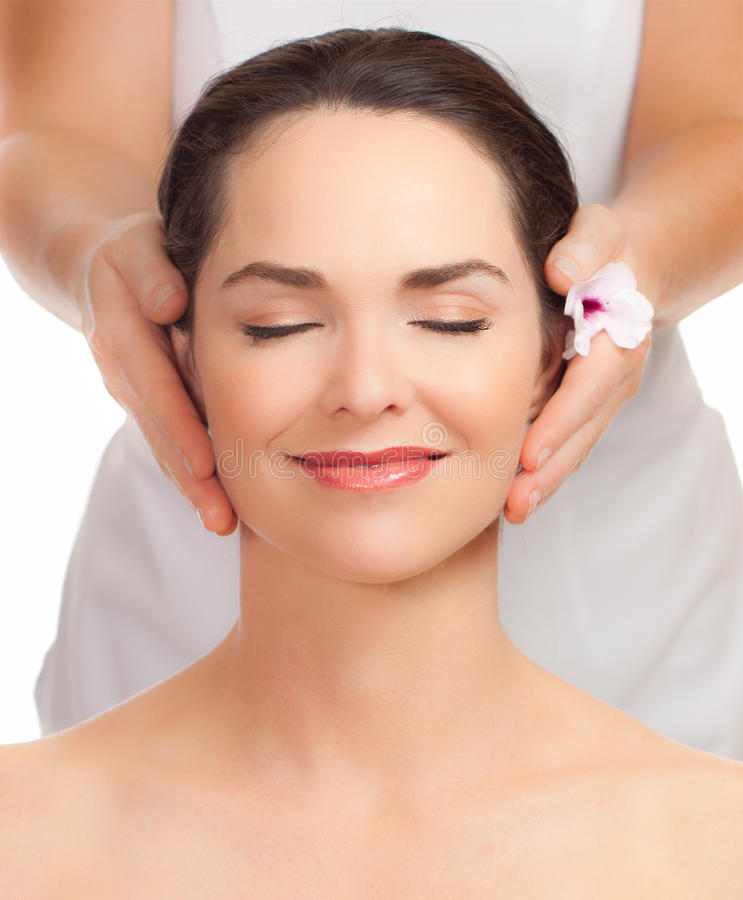 Beautiful young woman getting facial massage royalty free stock photos