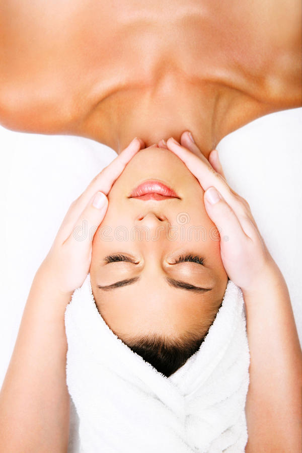 Beautiful young woman getting a massage. royalty free stock image