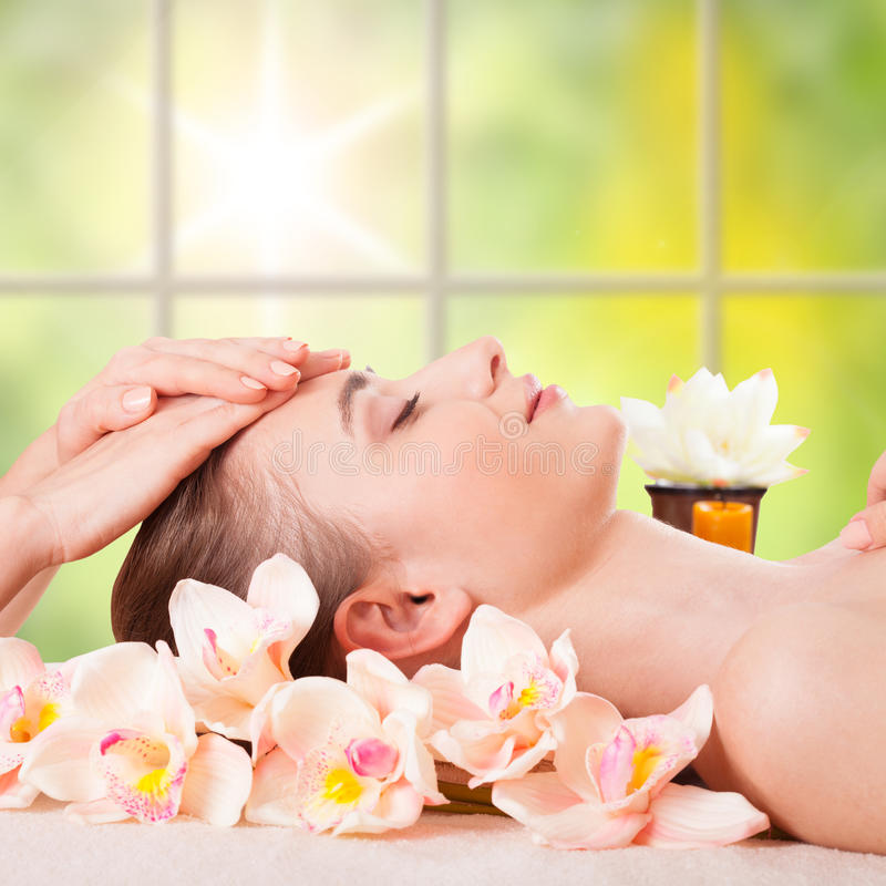 Beautiful young woman getting spa massage. Beautiful Young Woman Getting Massage Facial and Body in Spa Salon. Treatment Cosmetics Beauty Care Body Herbs stock image