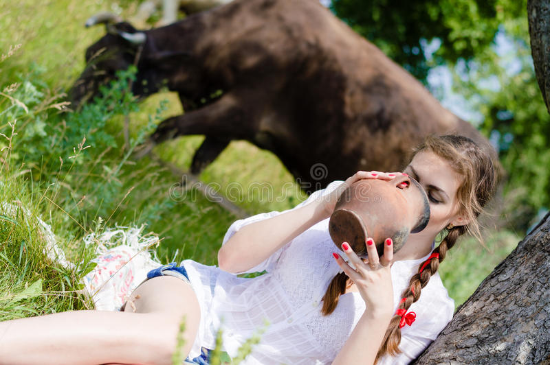 beautiful young woman girl drinking cow milk royalty free stock photography
