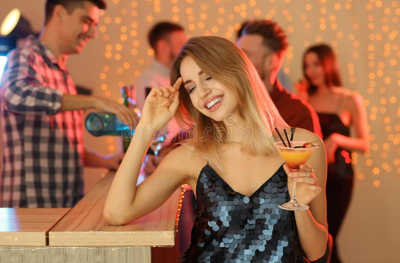 Beautiful young woman with glass of martini cocktail royalty free stock photos