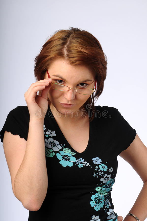 The beautiful young woman with glasses royalty free stock image