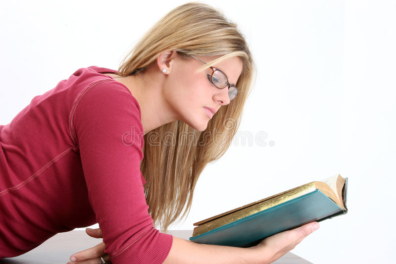 Beautiful Young Woman In Glasses Reading Book royalty free stock photos