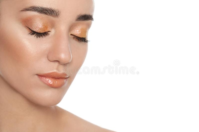 Beautiful young woman with glitter makeup on  background stock photography