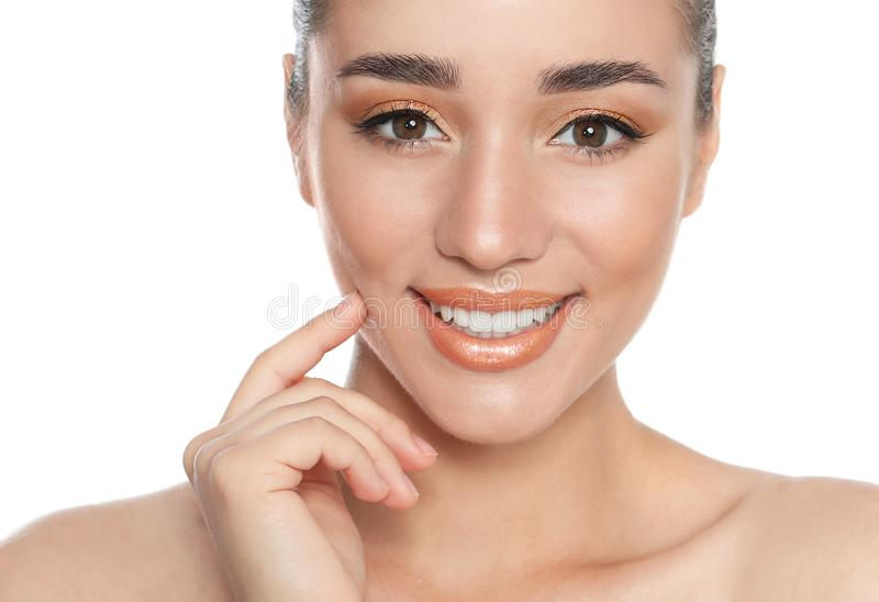 Beautiful young woman with glitter makeup on white royalty free stock photography