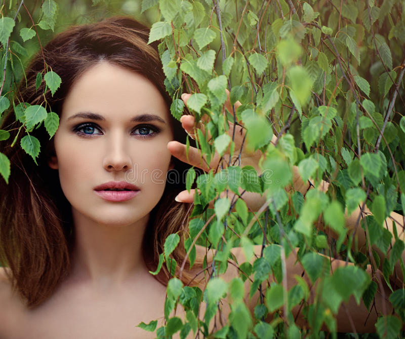 Beautiful Young Woman with Green Birch Leaves. royalty free stock images