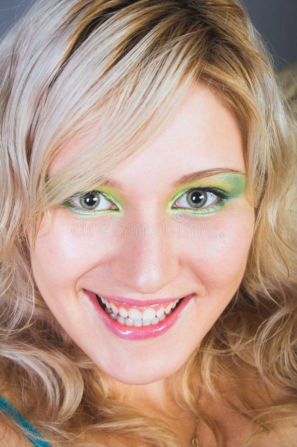 Beautiful young woman with green eyes smiling stock photography