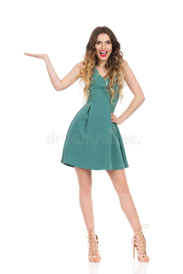 Elegant Woman In Mini Dress And High Heels Is Presenting And Talking royalty free stock photos