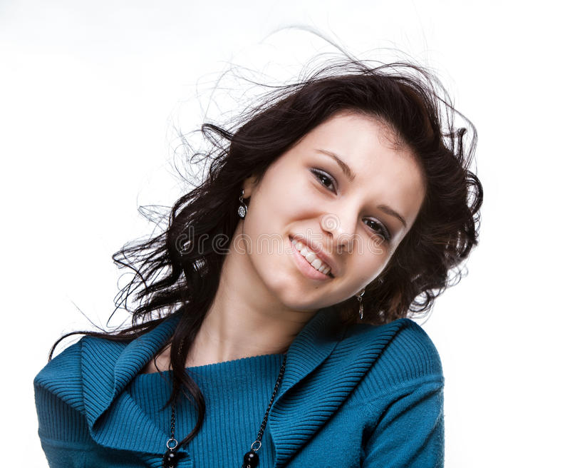Beautiful young woman with hair flying stock photo