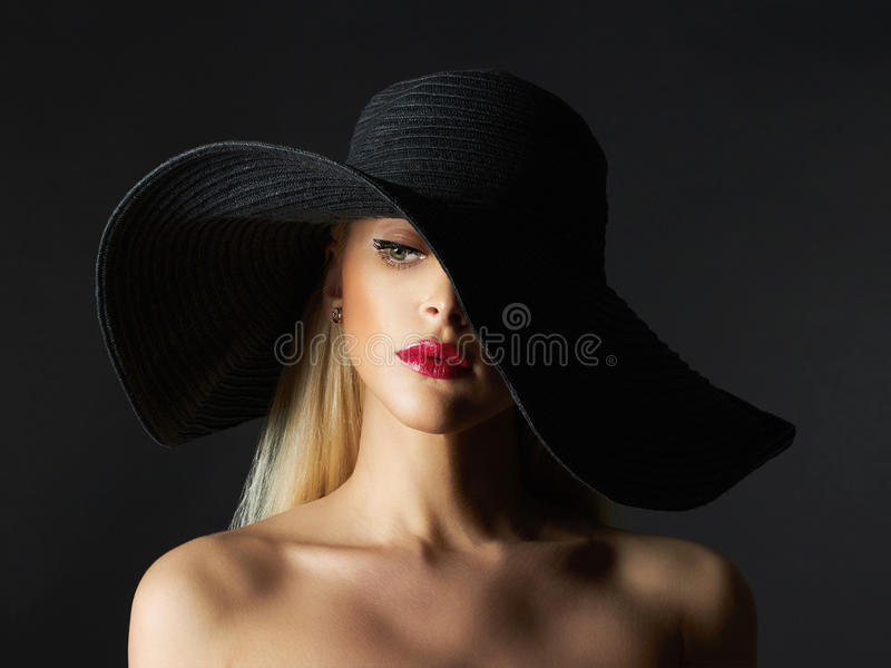 Beautiful young woman in hat. Fashion beauty blonde girl with make-up royalty free stock images