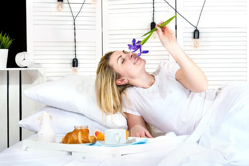 Beautiful young woman having breakfast in bed. Surprise from beloved husband. Celebrating a woman`s day, mother`s day. Celebrating a woman`s day, mother`s day stock photography
