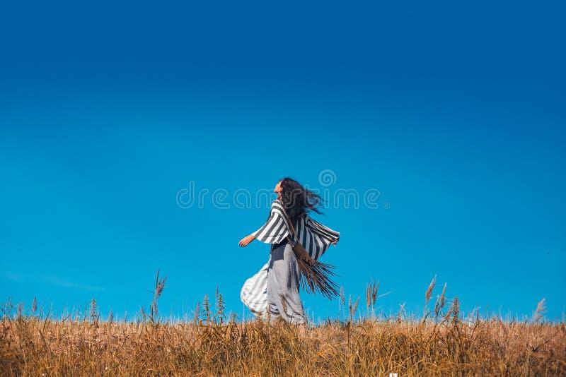 Beautiful young woman having fun on the field stock photo