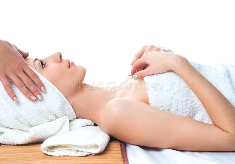 Beautiful young woman having massage in spa royalty free stock photography