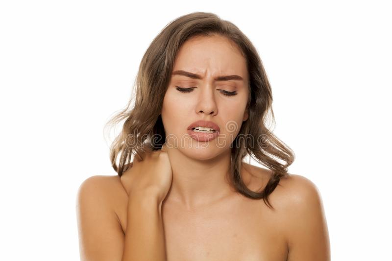 Woman with painful neck royalty free stock photography